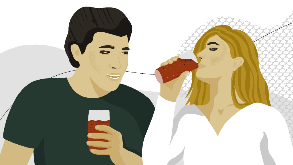 a man and lady drinking a healthy smoothie